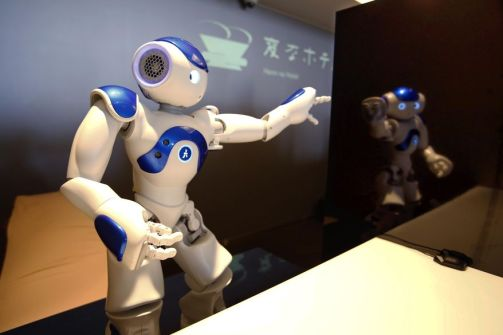 "A receptionist robot performs during a demonstration for the media at the new hotel, aptly called Henn na Hotel or Weird Hotel, in Sasebo, southwestern Japan, Wednesday, July 15, 2015. From the receptionist that does the check-in and check-out to the porter that's a stand-on-wheels taking luggage up to the room, the hotel, that is run as part of Huis Ten Bosch amusement park, is ""manned"" almost totally by robots to save labor costs. (AP Photo/Shizuo Kambayashi)"